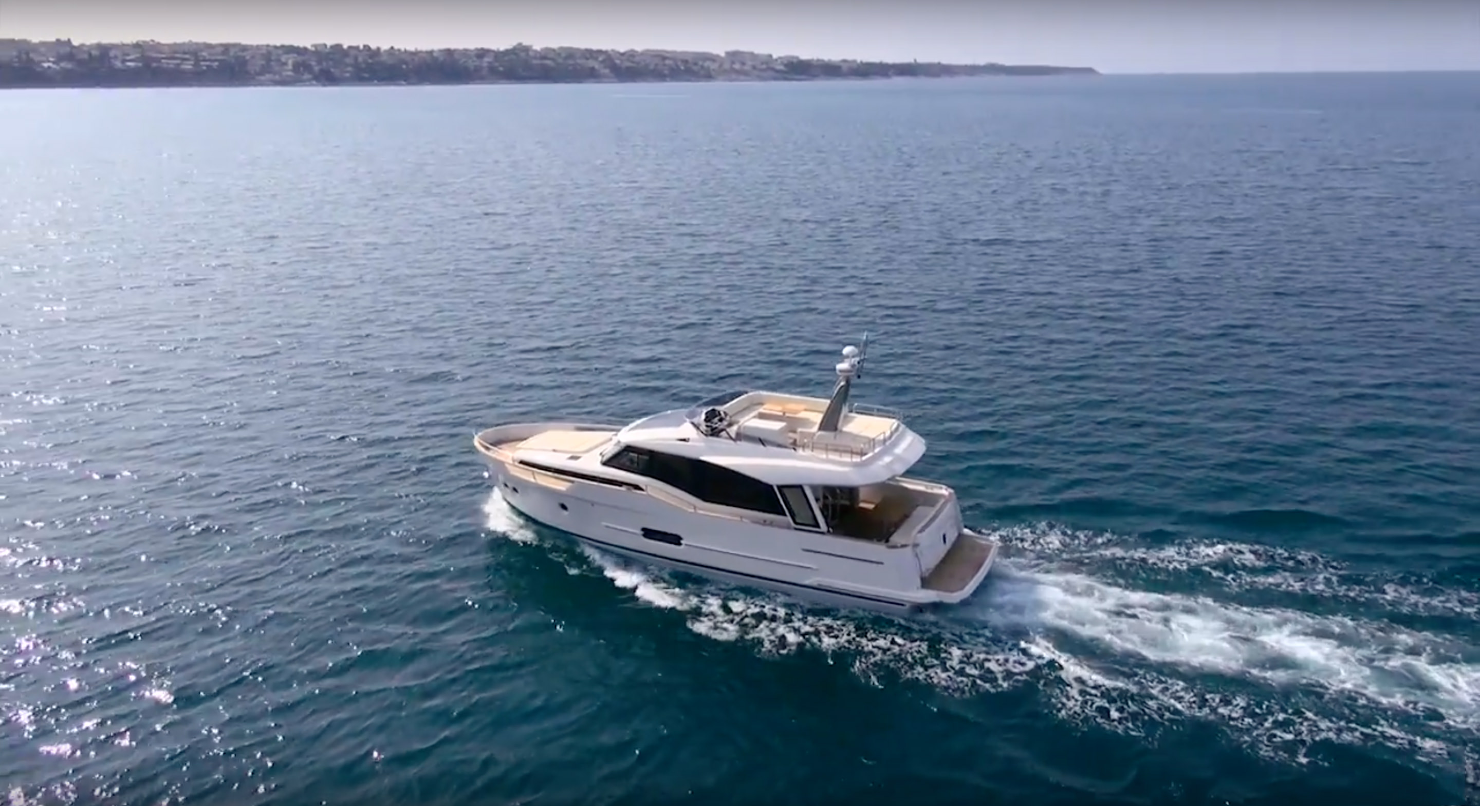 Yacht pictures. A Greenline Yacht cruising on the water.